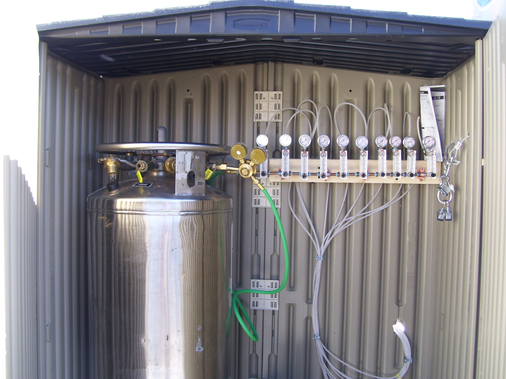 Oxygen tank housed in a small remediation shed.